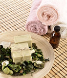 Spa organic soap and massage oil stock photos