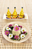 Spa organic soap, massage oil and flowers Stock Photos