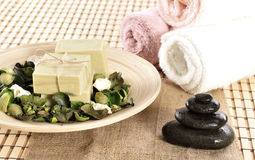 Spa organic soap and massage stones Stock Image