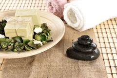 Spa organic soap and massage stones Royalty Free Stock Image