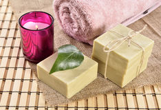 Spa organic soap, towel and candle Royalty Free Stock Image