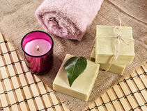 Spa organic soap, towel and candle Royalty Free Stock Images