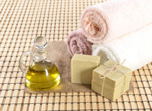 Spa organic soap, towel and oil Royalty Free Stock Photos