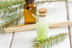 Spa with organic spruce oil and sea salt in glass bottles on white table background Stock Image