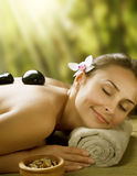 Spa outdoor. Beautiful Young Woman at Spa outdoor.Stone Massage Royalty Free Stock Image