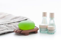 Spa Package with aloe vera soap, towel and lotion bottles. Isolated Spa Package including green aloe vera soap, a soft grey towel and lotion bottles Stock Image