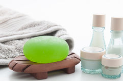 Spa Package with aloe vera soap, towel and lotion bottles. Isolated Spa Package including green aloe vera soap, a soft grey towel and lotion bottles Stock Photos