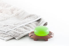 Spa Package including Aloe Vera Soap and Towel. Isolated Spa package including beautiful soft grey towel and green aloe vera soap Stock Photos
