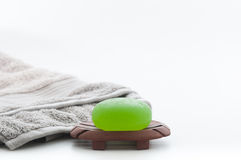 Spa Package including Aloe Vera Soap and Towel. Isolated Spa package including beautiful soft grey towel and green aloe vera soap Stock Images