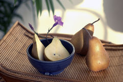 Spa Pears. Healthful Low Calorie Pears in a tropical spa setting. Morning light Royalty Free Stock Image