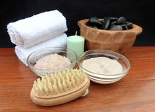 Spa pedicure tools. Spa Treatment Products; Scene on a wooden table with black background, includes mineral soaking salts, cream moisturizer, scrub exfoliating Stock Image