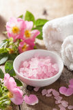 Spa with pink herbal salt and wild rose flowers Royalty Free Stock Photo
