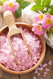 Spa with pink herbal salt and wild rose flowers Stock Images