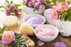 Spa with pink herbal salt and wild rose flowers clover Stock Images