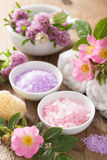 Spa with pink herbal salt and wild rose flowers clover Stock Image