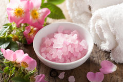 Spa with pink herbal salt and wild rose flowers Stock Photos