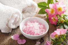 Spa with pink herbal salt and wild rose flowers Stock Image