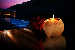 Spa Pool. A ceramic candle holder on a spa pool twilight background Royalty Free Stock Images