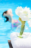 Spa Pool. Summer and pool spa concept  with flowers and towel Stock Images