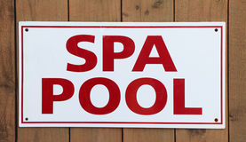Spa Pool Sign. On a wood background Royalty Free Stock Images