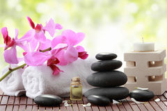 Spa. A portrait of Essential oil , candle, towel and stones for spa teraphy Stock Photos