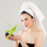 Spa Portrait of Healthy Woman with Black Stones and Green Bamboo Royalty Free Stock Images
