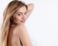 Spa portrait of smiling blonde woman over the shoulder Stock Image