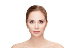 Spa portrait of woman with arrows on her face on white backgroun Royalty Free Stock Images