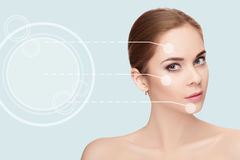 Spa portrait of young, beautiful woman with dotted arrows on fac Royalty Free Stock Photo
