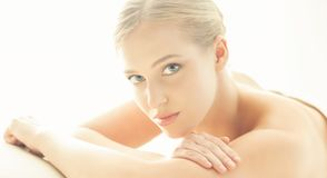 Spa portrait of young, healthy and beautiful woman isolated on white. stock photography