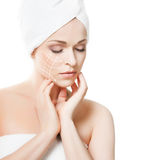 Spa portrait of a young and healthy woman. With arrows on her face. Plastic surgery concept Royalty Free Stock Image