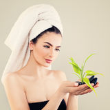 Spa Portrait of Young Woman with White Bath Towel. And Green Bamboo Leaves Stock Photo