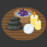 Spa procedure accessories on makisu woven mat. Spa procedure accessories on makisu mat. Spa massage pebbles, candles, bath bomb and aroma water in bowl Royalty Free Stock Photo
