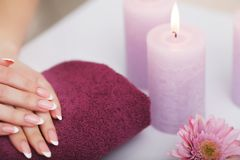 Spa Procedure. Woman In Beauty Salon Holding Fingers In Aroma Ba Stock Photo
