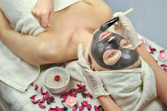 Spa procedure. Woman relaxing at spa salon Stock Photography