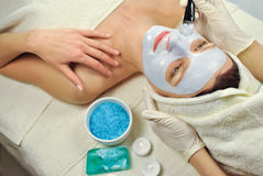 Spa procedure. Woman relaxing at spa salon Royalty Free Stock Image