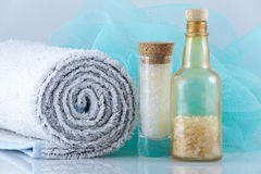 Spa products. Cosmetics & white towel Stock Photography