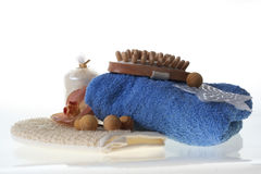 Spa products. Bath products including folded towels,bath salts and flowers Stock Photos