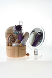 Spa products. Bath products including folded towels,bath salts, flowers and mirror Stock Image