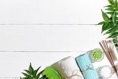 Spa products. Bath salts, soap, candles and towel. Flat lay on white wooden background, top view. Stock Image