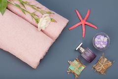 Spa products for facial and body care. Sea salt, homemade soap and towel. Spa products for facial and body care. Natural sea salt, homemade soap, perfume and stock images