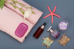 Spa products for facial and body care. Sea salt, homemade soap and towels. Spa products for facial and body care. Natural sea salt, homemade soap, aromatic oil stock images