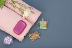 Spa products for facial and body care. Sea salt, homemade soap and towels. Spa products for facial and body care. Natural sea salt, homemade soap and pink towels stock images