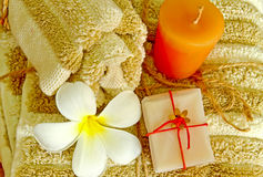 Spa products with flower and candle on towel Stock Image