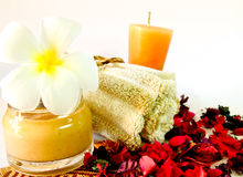 Spa products with flowers and candles Royalty Free Stock Photos