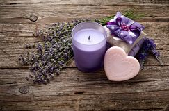 Spa products and lavender flowers on a old wooden background. Lavender soap, candle and sachet on a old wooden background stock photography