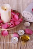 Spa products with rose petals, oil, towel Stock Image