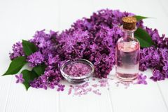 Spa products and lilac flowers. Spa products, salt and oil and lilac flowers Stock Image