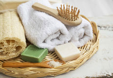 Spa products with towels,bath salt and soaps. Spa setting with towels,bath salt and jasmin and olive soaps Royalty Free Stock Photography
