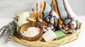 Spa products with towels,bath salt and soaps. Spa setting with towels,bath salt and jasmin and olive soaps,dried lavender stock images